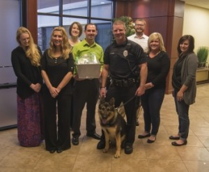 Pictured (L-R) Sasha Ridgway, Casee Trapp, Katy Wehmeier, James Brandly, K9 Officer Enzo, Officer Jason Davis, John Williams, Amanda Griffith, and Eva Peters.